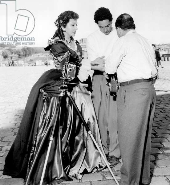 Claudette Colbert and Clement Duhour on Set of Film Affairs in Versailles July 18, 1953 (b/w photo)