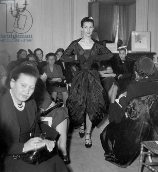 Showing of Christian Dior Collection : The Model Lucie Daouphars, Called Lucky, February 1951 (b/w photo)