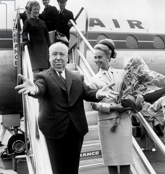 Director Alfred Hitchcock With Actress Tippi Hedren Arriving in Nice Cote D'Azur Airport For Cannes Film Festival To Show The Film The Birds May 10, 1963 (b/w photo)