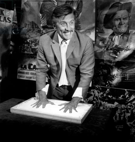 Kirk Douglas Leaving his Handprints Hands Prints in Plaster in Parisian Movie Theatre Rex August 29, 1967 For Presentation of Film The War Wagon (b/w photo)