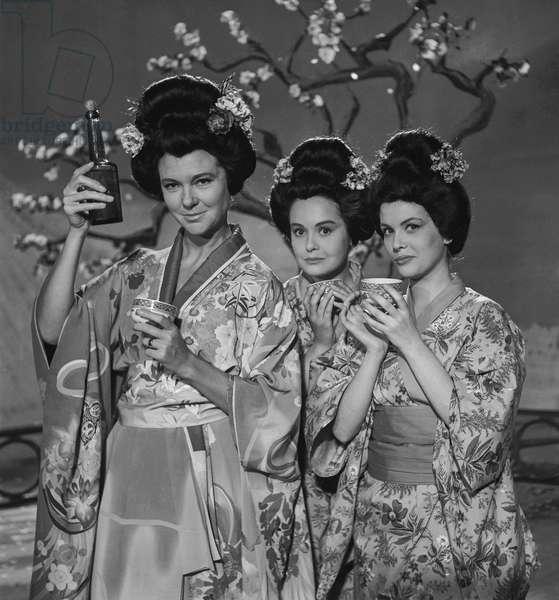 "French actresses Sophie Desmarets, Annie Sinigalia and Marie Jose Ruiz dressed up as Japanese women on set of film ""La famille Fenouillard"" on September 23, 1960 (b/w photo)"