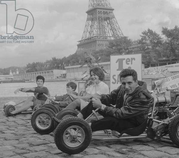 Opening of the 1st Karting show in Paris, October 7, 1960 : Rika Zarai, Joel Flateau, Michele Verez and Gilbert Becaud (b/w photo)