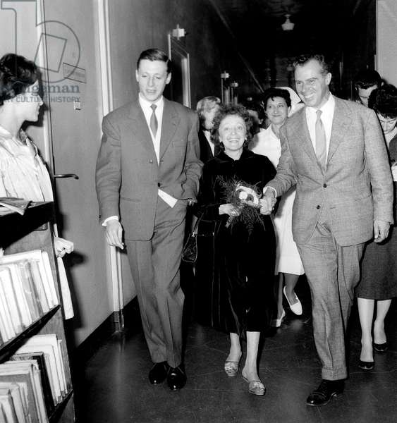 French Singer Edith Piaf Leaving Hospital With her Agent Louis Barrier and on The Left Julien Bouquet October 14, 1959 (b/w photo)