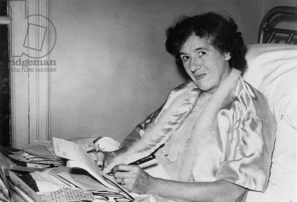 Enid Blyton, Writer, here at Hospital, After She Has Been Bitten By A Dog, Reading Mail of Fans, November 10, 1952 (b/w photo)