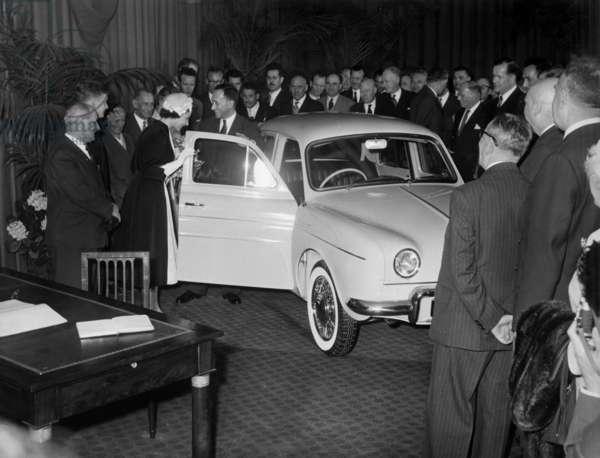 Queen Elizabeth Ii of England With Pierre Dreyfus (Chairman of Renault) Looking at Dauphine Car in Flins, France, April 10, 1957 (b/w photo)
