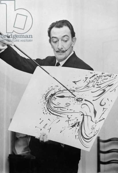 Salvador Dali With One of The Painting of his New Exhibition, May 13Th 1954 (b/w photo)