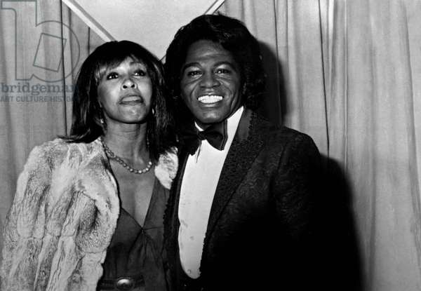 Singers Tina Turner and James Brown in 1982 at Grammy Awards (b/w photo)