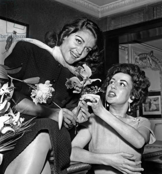 """Dalida and Nicole Barclay (Wife of Eddiebarclay) during A Cocktail in Paris on September 17, 1957 To Celebrate Success of her Song """"Bambino"""" (b/w photo)"""