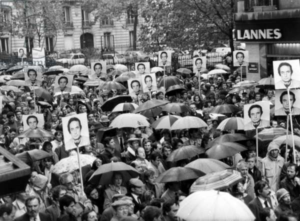 Supporting Demonstration To Jacques Abouchar, Journalist Prisoner in Afghanistan, Organised in Paris By The Committee For his Liberation, here Among Umbrellas Are Seen Some Portraits of Him Carried By The Demonstrators October 18, 1984 (b/w photo)