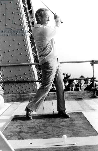 American Golfer Arnold Palmer Throwing The Ball From 2Nd Floor of Eiffel Tower For Opening of 8Th Lancome Golf Trophy October 13, 1977 (b/w photo)