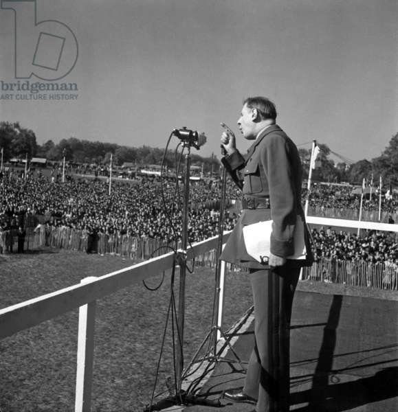 Charles de Gaulle speaking at a rally of French party RPF (Rassemblement du Peuple Francais) in Bagatelle, near Paris, May 1st, 1949 (b/w photo)