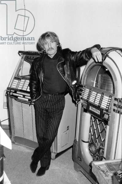 French Singer Christophe (Daniel Bevilacqua) Posing With Des Juke-Box at Collectors' Fair January 20, 1984 (b/w photo)