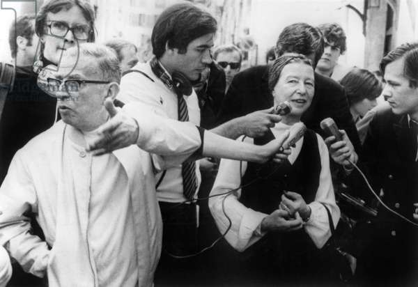"""Jean Paul Sartre and Simone De Beauvoir , Among Journalists, When Released From Police Station in Paris After Being Arrested Because They Distributed """"La Cause Du Peuple"""" (The Newspaper of The Forbidden Organization """"The People'S Cause"""") June 26, 1970 (b/w photo)"""