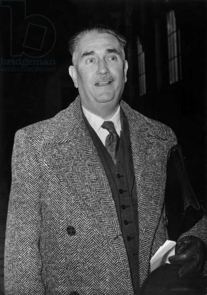 Colonel Soymie (Who was Head of the Civil Protection Service in Algiers) Arrives at the Palais De Justice de Paris To Testify at the Proces Des Barricades, 1st February 1961 -The Colonel Soymie Arriving at The Barricades Trial at The Law Courts in Paris, February 1, 1961 (b/w photo)