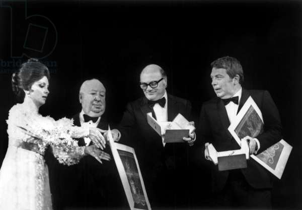 Cannes Film Festival on May 22, 1972 : Gina Lollobrigida and Alfred Hitchcock Giving The Palme D'Or To Francesco Rosi and Elio Petri (b/w photo)