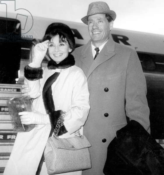 Audrey Hepburn and Husband Mel Ferrer at Paris Airport January 11, 1962 (b/w photo)