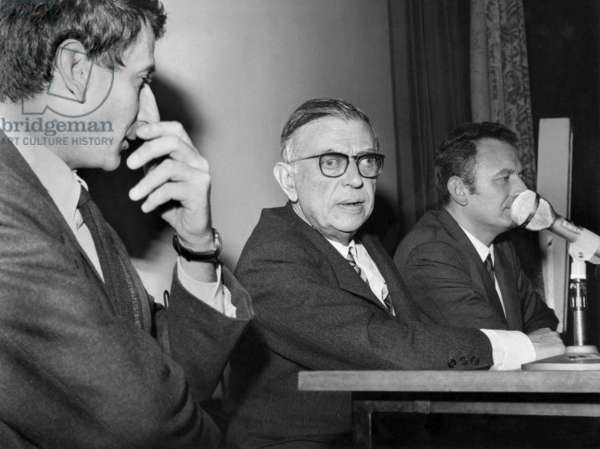 """Author Jean Paul Sartre , With Director Serge Roullet (L) and Radio-Journalist Jean Garlier (R) during Meeting With American and Parisian Students After Presentation (At The Same Time in Paris and New York) of Film """"Le Mur (The Wall)"""" After Sartre'S Book on October 23, 1967 (b/w photo)"""