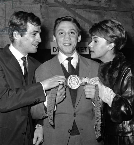 French Boxer Maurice Auzel Between Jean-Paul Belmondo and Jeanne Moreau on March 6, 1963 (b/w photo)