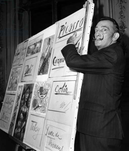 Salvador Dali Shows A Painting Which Will Be Sold By Auction in New York, Benefits Goes To The 'Societe Des Amis De L'Enfance', November 4, 1966 (b/w photo)