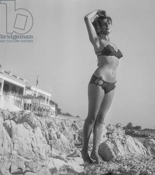 "Actress Myriam Bru wearing a swimsuit (bikini, ""vine leaf""), France, September 1949 (b/w photo)"
