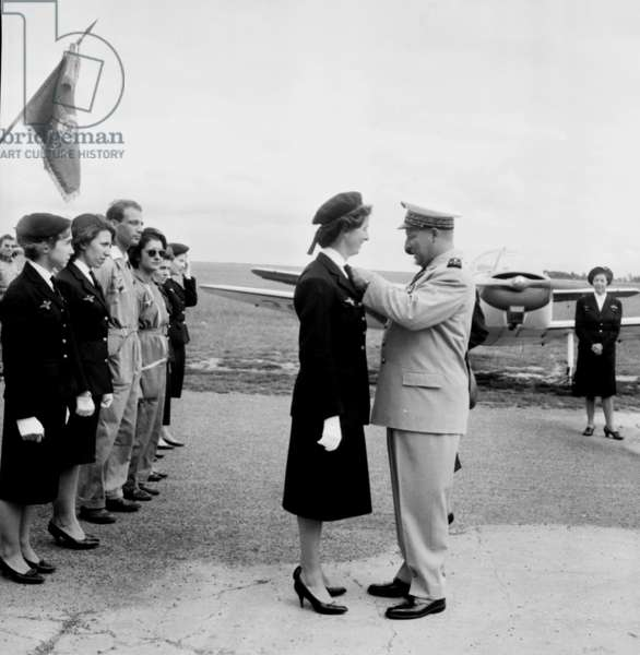 French General Maurice Challe Giving A Decoration To A Paratrooper Nurse of The Red Cross in Guyancourt, France, June 12, 1960 (b/w photo)