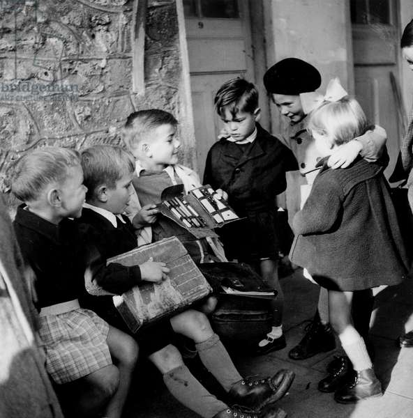 Start of School Year in Primary School in France, October 19, 1947 : Schoolboys With Schoolbags (b/w photo)