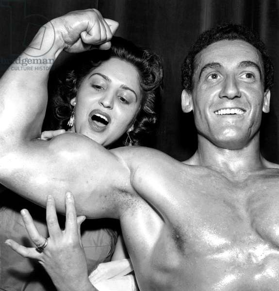 Candidate Rodrigo Showing his Musles For Men'S Beauty Contest in Paris March 8, 1958 (b/w photo)