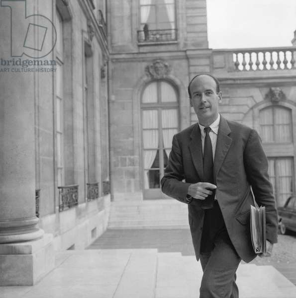 French politician Valery Giscard d'Estaing (VGE) arriving at the Elysee, Paris, to attend the council of ministers, August 24, 1960 (b/w photo)