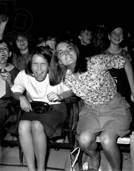 Fans during Concert of Beatles at The Olympia in Paris in January 1964 (b/w photo)
