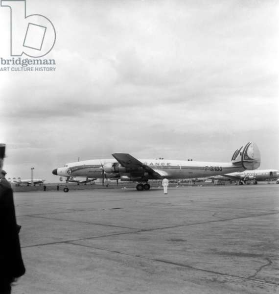 """Departure of Charles De Gaulle For A Visit in Madagascar and Africa (To Prepare The Referendum) : here A """"Super Starliner"""" Plane (Air France) at Orly Airport, Paris, August 20, 1958 (b/w photo)"""