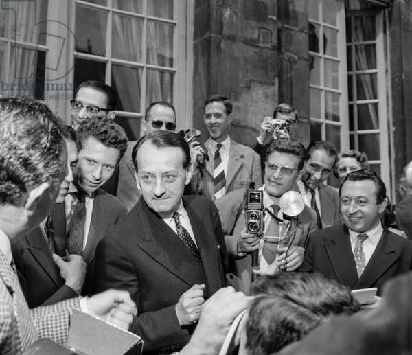 Andre Malraux, new minister in charge of information, after meeting with DeGaulle, Matignon Hotel, Paris, June 3, 1958 (b/w photo)