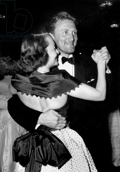 Olivia De Havilland Dancing With Kirk Douglas at Cannes Film Festival April 16, 1953 (b/w photo)
