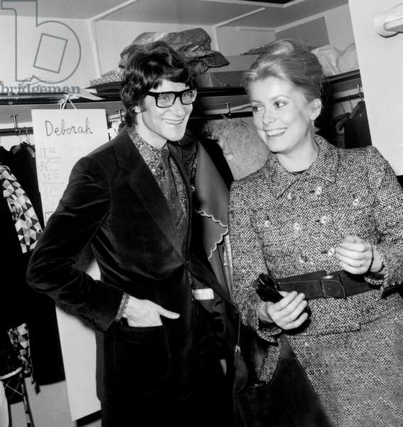 French Dress Designer Yves Saint Laurent With Actress Catherine Deneuve After Fashion Show of Winter-Summer Collection January 29, 1968 (b/w photo)