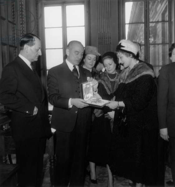 Actors Maurice Escande and Gisele Casadesus Looking The Brooch Given To Themby Andre Malraux For Comedie Francaise February 16, 1960 (b/w photo)
