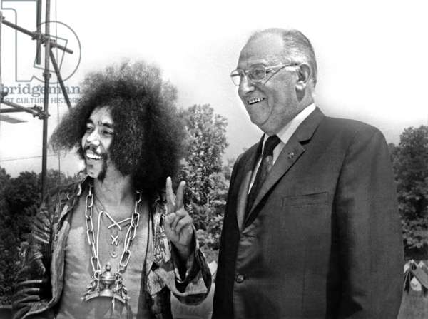 """General Clement In The Company Of The Chef Of The Magnetic Band After Got Authorization Of The Pop Festival D'Aix En Provence Rechristens """"Concert De Musique Progressive"""" July 31, 1970 (b/w photo)"""