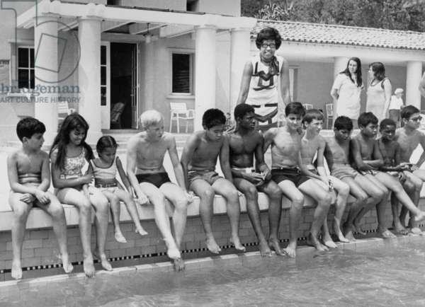 Josephine Baker and her Adopted Children at The Side of A Swimming Pool in her Villa in Roquebrune Cap Martin in 1969 (b/w photo)