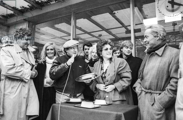 "The ""Prix Guy Lux"" (horse race) in Auteuil Hippodrome, Paris, November 19, 1985 : Stephane Collaro, Dalida, Coluche, Rika Zarai, Dave (Wouter Otto Levenbach) and Guy Lux (b/w photo)"