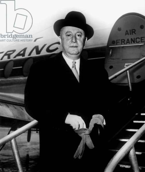 French Couturier Christian Dior (1905-1957) Before Flying To Copenhagen in February 1957 (b/w photo)