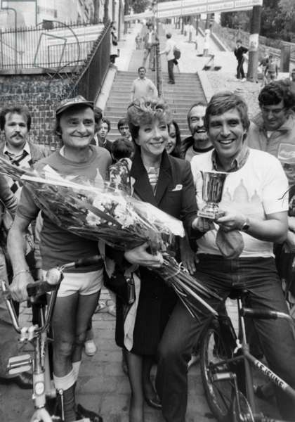 Marthe Mercadier Congratulating Sim and Jean-Pierre Foucault After They Cycled Down The Stairs in Montmartre, Paris, September 23, 1982 (b/w photo)