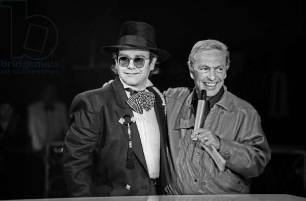 Singer Elton John and Presenter Guy Lux during TV Programme