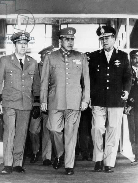 Chilian General Augusto Pinochet (C) during Visit in Argentina Welcome By General Peron (R) at Military Airport in Moron May 21, 1974 (b/w photo)