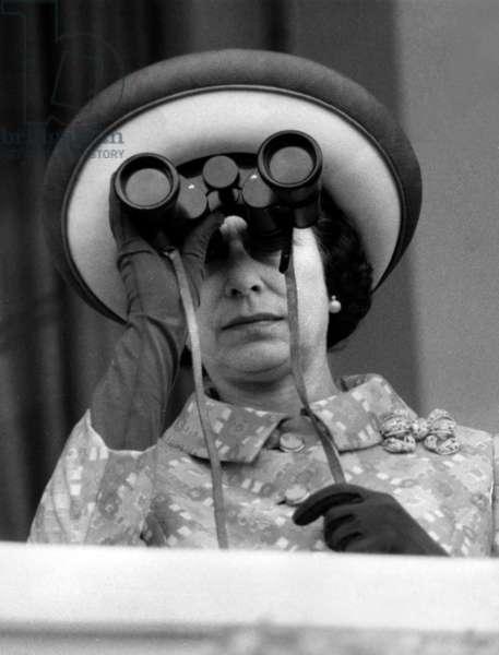 Queen Elizabeth Ii of England Watching Horse Races With Binoculars, Especially The Special Race