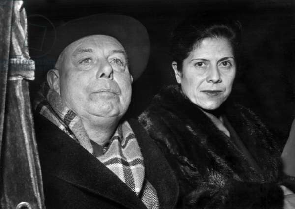 Director Jean Renoir and his Wife Arriving at Paris After 12 Years Absence For A Film About Van Gogh October 28, 1953 (b/w photo)