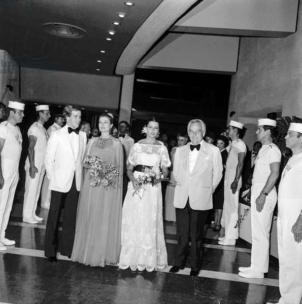 The Gala of the Red Cross in Monaco, at the Monte Carlo Sporting Club, August 9, 1976 : Prince Albert of Monaco (future Albert II), Princess Grace of Monaco, Princess Caroline and Prince Rainier III (b/w photo)