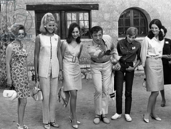 Yves Montand Giving Lesson To Play The Boules To Misses in Saint-Paul-De-Vence, France, June 1St, 1967 : L-R : Miss Switzerland, Miss Europe 1966, Miss Turkey, Yves Montand, Miss Belgium, Miss Ireland (b/w photo)