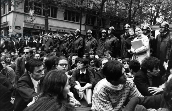 May 68 : Students Demonstrating in Paris Near The Sorbonne, Paris, Under Look of Policemen, May 9, 1968 (b/w photo)