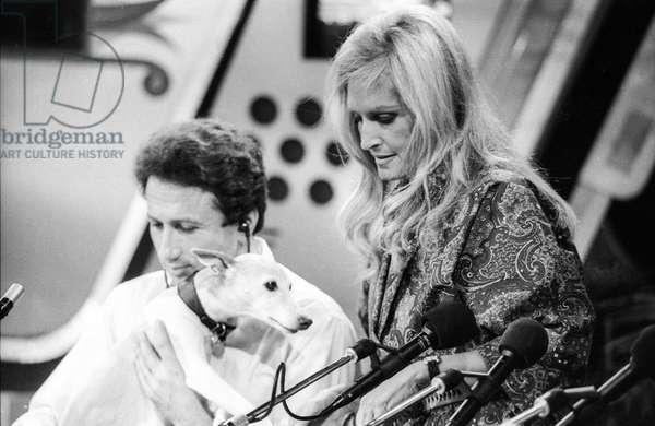 French presenter Michel Druker with his dog Zaza and French singer Dalida on 'Studio 1' radio programme in Paris, on October 8, 1985