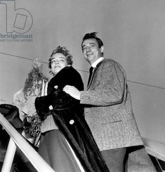 Simone Signoret and Yves Montand Leaving For Moscow, December 16, 1956, at Orly Airport, Paris (b/w photo)