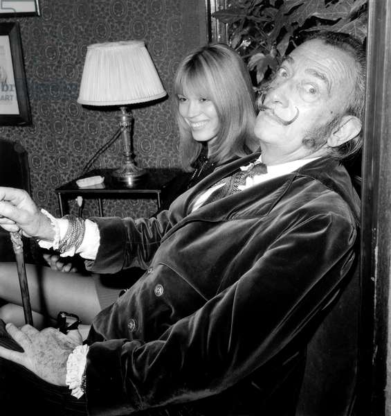 Amanda Lear and Salvador Dali on December 29, 1969 at Maxim'S Restaurant in Paris (b/w photo)