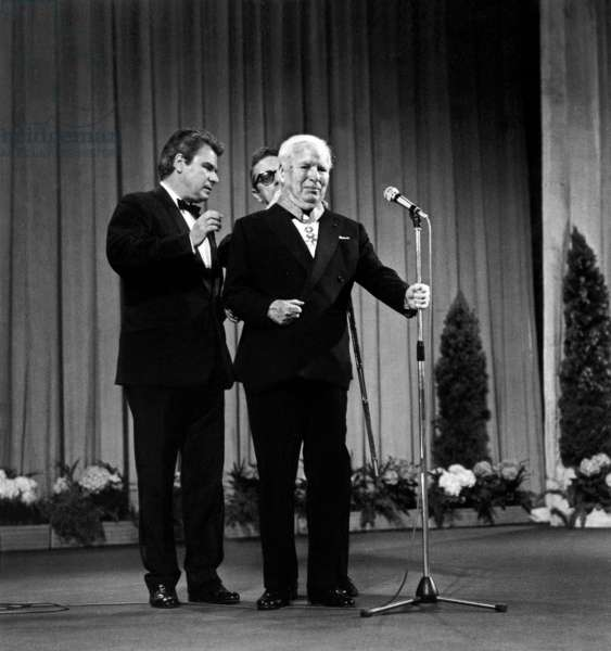 Charlie Chaplin Receiving The Legion of Honour Commander Tie at Opening Night of Cannes Film Festival May 15, 1971 (b/w photo)